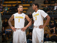 Justin Cobbs of California talks with Tyrone Wallace of California during the game against UC Irvine at Haas Pavilion in Berkeley, California on December 2nd, 2013.  California defeated UC Irvine, 73-56.