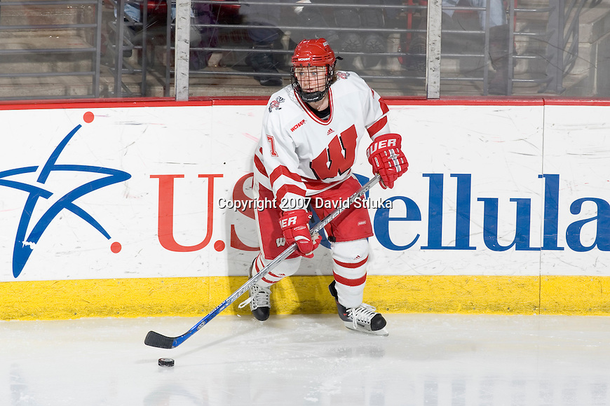 MADISON, WI - FEBRUARY 11: Meghan Duggan #7 of the Wisconsin Badgers women's hockey team handles the puck against the Ohio State Buckeyes at the Kohl Center on February 11, 2007 in Madison, Wisconsin. The Badgers beat the Buckeyes 3-2. (Photo by David Stluka)