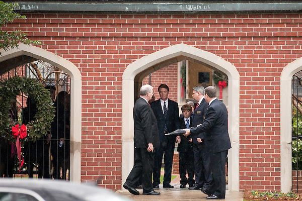 December 11, 2010. Raleigh, NC.. John Edwards, second from left, and his son Jack, prepare to leave the funeral of Edwards' wife, Elizabeth.. A funeral was held at the Edenton Street United Methodist Church to honor the life of Elizabeth Edwards, the estranged wife of former Democratic presidential candidate John Edwards, who died after an 6 year battle with breast cancer..