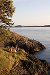 Couple, sea kayak camping, Strawberry Island, San Juan Islands, Puget Sound, Salish Sea, Washington State, U.S.A., Washington State Department of Natural Resources, Cypress Island Natural Resources Conservation Area,.model released,