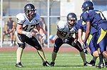 Santa Monica, CA 10/17/13 - Evan Conrow (Peninsula #42) and Nathan Hammes (Peninsula #85) in action during the Peninsula vs Santa Monica Junior Varsity football game at Santa Monica High School.