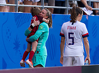 REIMS,  - JUNE 24: Alyssa Naeher #1 embraces her nephew during a game between NT v Spain and  at Stade Auguste Delaune on June 24, 2019 in Reims, France.