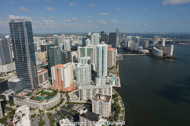 Condominium towers on Brickell Avenue area, aerial view, Miami, FL Four Season Hotel tower, center-left.  Brickell Bay Drive on right.