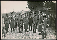 BNPS.co.uk (01202 558833)<br /> Pic: Warwick&Warwick/BNPS<br /> <br /> German officers at Colditz<br /> <br /> A remarkable archive of photos which provide a glimpse inside the infamous Colditz Castle has come to light.<br /> <br /> The photos show the ingenuity of the Allied POWs who devised ever-bolder ways to escape from the German stronghold during World War Two.<br /> <br /> One image is of a dummy they would hold up to trick the German guards into believing the escaper was still with them during parade head counts. Others reveal the tunnels which were dug using tools smuggled into the 11th century castle in care parcels.<br /> <br /> The photos were taken by the official Colditz photographer Johannes Lange, who was employed by the German Army to take pictures of failed Allied escape attempts. They were then distributed to other POW camps to alert the guards to the methods the inmates were using in their bids for freedom.<br /> <br /> The archive is being sold by a private collector with auctioneer Warwick & Warwick, with an estimate of £1,750.