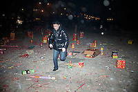 People celebrate the Lunar New Year by lighting fireworks in the White Horse Sculpture Park in Nanjing, Jiangsu, China.  White Horse Sculpture Park is known as Bai Ma Gong Yuan in Mandarin Chinese.  Lunar New Year is also known as Chinese New Year.  2009 is the Year of the Ox, the Year of the Cow, or the Year of the Bull, according to the Chinese zodiac.  Niu is the Mandarin word for ox/cow/bull.