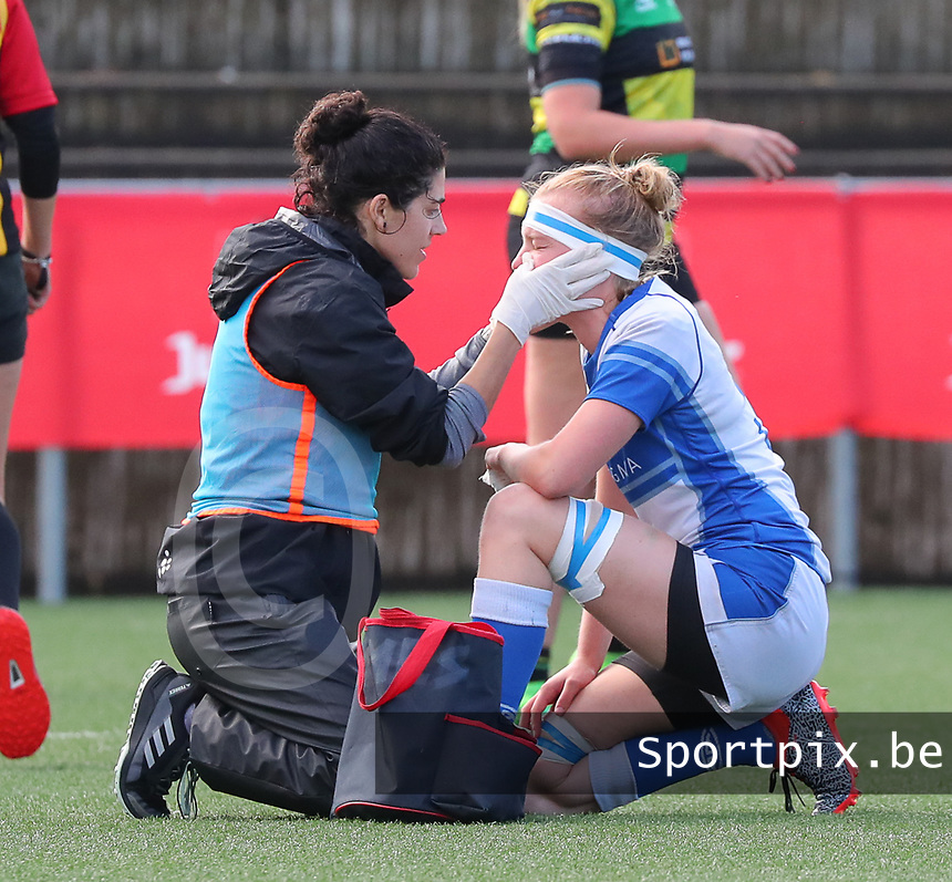 20190928 - Neder Over Hembeek, BELGIUM : AAC Amsterdam's pictured is being treated during the female rugby match between the Dendermonde RC Women  and AAC Amsterdam Rugby Women, this is the final of the BeNeCup  on Saturday 28th September 2019 at the Nelson Mandela Stadium , Belgium. PHOTO SPORTPIX.BE | SEVIL OKTEM