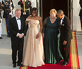 US President Barack Obama and First Lady Michelle Obama welcome Erna Solberg, Prime Minister of Norway (2nd right) and spouse Sindre Finnes (left) as they arrive May 13, 2016 at The White House in Washington, DC to attend a State Dinner while participating in the U.S.- Nordic Leaders Summit.<br /> Credit: Chris Kleponis / CNP