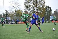 VOETBAL: HEERENVEEN: 07-11-2015, Heerenveense Boys - Zwaagwesteinde, Mehdi Charafeddine (#11), Auke Westra (#5)), uitslag 2-3, ©foto Martin de Jong