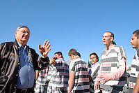 "Phoenix, Arizona. April 17, 2009 - Nine hundred Maricopa County Jail pre-sentenced male inmates were moved from one housing facility to another in the massive Maricopa County Jail Complex, located in southwest Phoenix . The 900 inmates walked in chains wearing their black and white striped jail uniforms from the Lower Buckeye Jail and the Towers facility. According to the Maricopa County Sheriff's Office (MCSO), moving these inmates opened up 200 more beds for medium and maximum security jail inmates. In a press release, Maricopa County Sheriff Joe Arpaio said: ""For 16 years, I've had a vacancy sign shining over Tent City to tell everybody we will always find a way to make room for more law breakers. Even in hard times like these, I'm not about to allow the early release of inmates because we run out of bed space for bad guys."" The transfer of inmates was overseen by Sheriff Arpaio and secured by the Sheriff's SWAT and Special Response teams as well as deputies and armed posse. Just a few weeks before, Sheriff Arpaio was criticized for what was considered the parading another 220 jail inmates from one jail to the Tent City Jail. Photo by Eduardo Barraza © 2009"