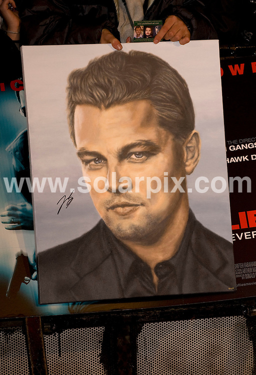 **ALL ROUND PICTURES FROM SOLARPIX.COM**.**WORLDWIDE SYNDICATION RIGHTS**.Guest arrivals for the UK premiere of the film Body Of Lies, held at Vue West End, 3 Cranbourn Street, London, UK. 6th November 2008..This pic: Leonardo DiCaprio fan picture is signed by the man himself..JOB REF: 7809 SSD     DATE: 06_11_2008.**MUST CREDIT SOLARPIX.COM OR DOUBLE FEE WILL BE CHARGED* *UNDER NO CIRCUMSTANCES IS THIS IMAGE TO BE REPRODUCED FOR ANY ONLINE EDITION WITHOUT PRIOR PERMISSION*