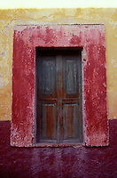 Window and colorful wall  in San Miguel de Allende, Mexico. San Miguel de Allende is a UNESCO World Heritage site..