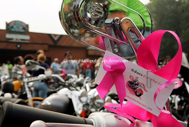 WOLCOTT, CT - 14 AUGUST 2005 -081405JS05--Pink ribbons adorne motorcycles as riders await the start of the third annual Bikers For The Cure ride to benefit the Susan G. Komen Breast Cancer Foundation Sunday at the Lily Lake Inn in Wolcott. All procedes collected are donated to the Connecticut affiliate of the Susan G. Komen Breast Cancer Foundation.   --Jim Shannon Photo--Lily Lake Inn; Wolcott, Bikers fo the Cure, Susan G. Komen Breast Cancer Foundation CQ