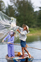 A fisherman casts his net on the Thu Bon River near Hoi An III.