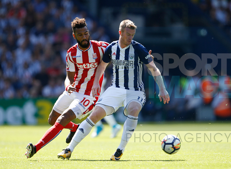 Eric Maxim Choupomoting of Stoke City tussles with Chris Brunt of West Bromwich Albion during the premier league match at the Hawthorn's Stadium, West Bromwich. Picture date 27th August 2017. Picture credit should read: Simon Bellis/Sportimage