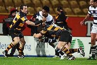 Taranaki hooker Laurence Corlett tackles Atieli Pakalani. Air New Zealand Cup rugby match - Taranaki v Auckland at Yarrows Stadium, New Plymouth, New Zealand. Friday 9 October 2009. Photo: Dave Lintott / lintottphoto.co.nz