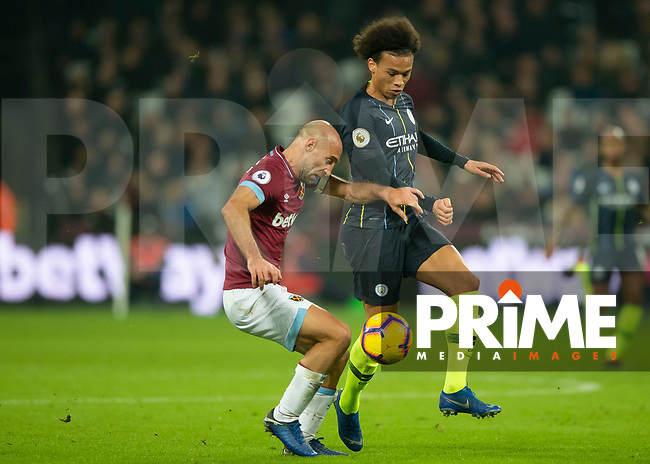 Pablo Zabaleta of West Ham United battles with Leroy Sané of Manchester City during the Premier League match between West Ham United and Manchester City at the Olympic Park, London, England on 24 November 2018. Photo by Vince Mignott / PRiME Media Images.