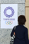 A woman looks at the Tokyo 2020 Olympic Games logo on display at the Tokyo Metropolitan building on April 27, 2016, Tokyo, Japan. After scraping the original design last year due to accusations of plagiarism; The Tokyo 2020 Logo Selection Committee settled this week on a simple indigo-and-white checkered circle design by Asao Tokolo as a new emblem for the 2020 Summer Olympic Games. The final decision was announced on Monday 25th April after the selection committee had checked through almost 15,000 design proposals. The new logos are already starting to appear on Tokyo 2020 related communications. (Photo by Rodrigo Reyes Marin/AFLO)