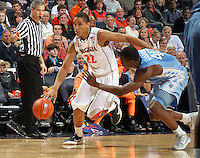 Virginia Cavaliers guard Malcolm Brogdon (22) drives past North Carolina Tar Heels forward Harrison Barnes (40) during the game in Charlottesville, Va. North Carolina defeated Virginia 54-51.