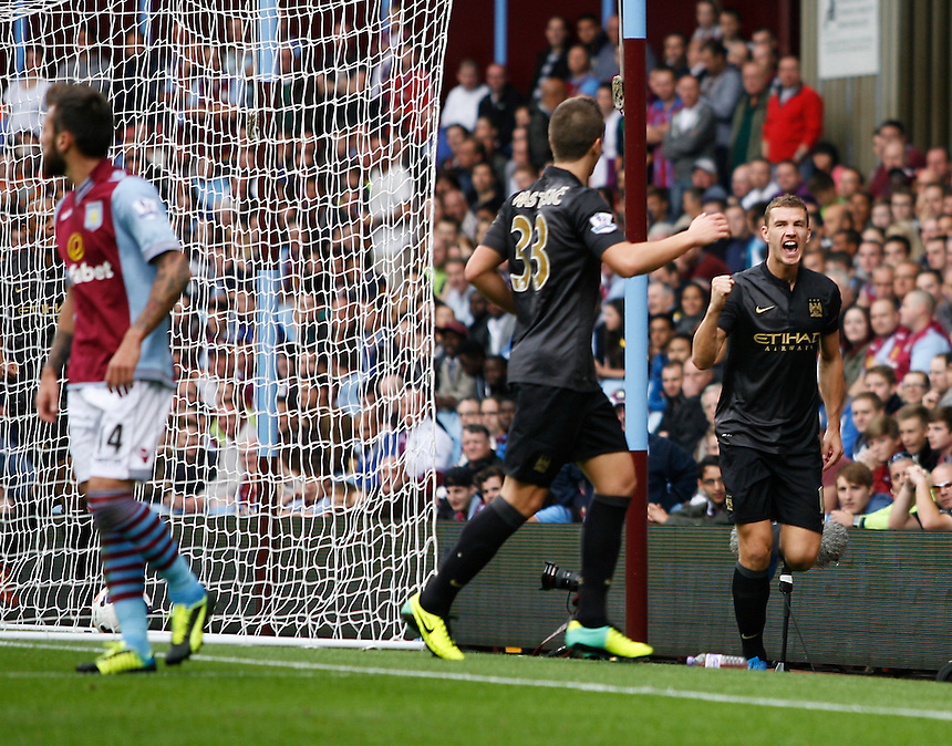 Manchester City's Edin Dzeko (R)celebrates scoring his sides second goal <br /> <br /> Photo by Jack Phillips/CameraSport<br /> <br /> Football - Barclays Premiership - Aston Villa v Manchester City - Saturday 28th September 2013 - Villa Park - Birmingham<br /> <br /> &copy; CameraSport - 43 Linden Ave. Countesthorpe. Leicester. England. LE8 5PG - Tel: +44 (0) 116 277 4147 - admin@camerasport.com - www.camerasport.com