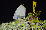 Donggang, Taiwan -- The King Boat sitting on top of a gigantic pile of paper money, which is then set alight to burn the boat.