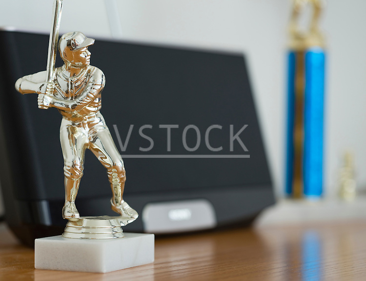 Baseball trophy on table