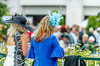 LOUISVILLE, KENTUCKY - MAY 04: Fashionable fans celebrate Thurby in the rain at Churchill Downs on May 4, 2017 in Louisville, Kentucky. (Photo by Jesse Caris/Eclipse Sportswire/Getty Images)