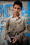 Twelve-year-old Habib Urhan operates a small street corner bike shop by himself in Kabul, Afghanistan. He makes about $2-4 USD a day, which combined with the pay from his laborer brother, supports their ten-person family.