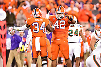 Charlotte, NC - DEC 2, 2017: Clemson Tigers linebacker Kendall Joseph (34) and Clemson Tigers defensive lineman Christian Wilkins (42) celebrate a sack during ACC Championship game between Miami and Clemson at Bank of America Stadium Charlotte, North Carolina. (Photo by Phil Peters/Media Images International)