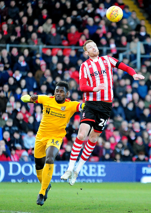 Lincoln City's Cian Bolger gets above Northampton Town's Aaron Pierre<br /> <br /> Photographer Andrew Vaughan/CameraSport<br /> <br /> The EFL Sky Bet League Two - Lincoln City v Northampton Town - Saturday 9th February 2019 - Sincil Bank - Lincoln<br /> <br /> World Copyright © 2019 CameraSport. All rights reserved. 43 Linden Ave. Countesthorpe. Leicester. England. LE8 5PG - Tel: +44 (0) 116 277 4147 - admin@camerasport.com - www.camerasport.com