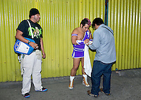 "Maximo a Lucha Libre wrestler, an ""Exotico"", meaning he fights as a gay Luchador with fans in the hallway of Arena Mexico. Mexico City"