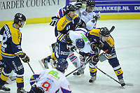 IJSHOCKEY: HEERENVEEN: THIALF: 16-01-2013, Friesland Flyers - Tilburg Trappers, Eindstand 1-3, Tony Ras (# 94) over de knie bij zijn tegenstanders, ©foto Martin de Jong