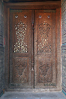 Detail of carved wooden door, Kurinish Khana or Throne Room, 1804-06, Kukhna Ark, Khiva, Uzbekistan, pictured on July 6, 2010, in the afternoon. The Kukhna Ark is the original home of the Khans. Although its foundations are 5th century, most of the complex is 19th century. Khiva, ancient and remote, is the most intact Silk Road city. Ichan Kala, its old town, was the first site in Uzbekistan to become a World Heritage Site(1991). Picture by Manuel Cohen.