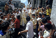 February 22, 1986. Havana Cuba. The cathedral was too small for the crowd, so communion was given to believers standing outside on the plaza.
