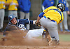 Connor Sullivan #33 of St. Dominic, right, gets tagged out by Kellenberg catcher Rob Weissheir #12 in the bottom of the second inning of the CHSAA varsity baseball semifinals at Farmingdale State College on Tuesday, May 24, 2016. Kellenberg won by a score of 5-3.