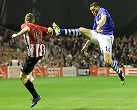 5.04.2012 Bilbao, Spain. Uefa Europa League. Picture show Muniain (L) and  Papadopoulos (R) in action during match between Athletic Club against Shalke 04 at San Mames stadium