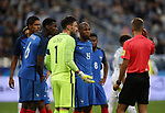 Referee Davide Massa gets help from the video assistant before sending off Raphael Varane during the Friendly match at Stade De France Stadium, Paris Picture date 13th June 2017. Picture credit should read: David Klein/Sportimage