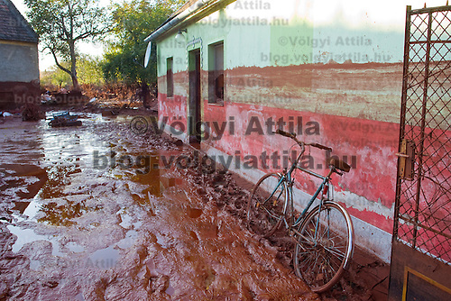 Devecser in Hungary's Veszprem county has been flooded by toxic sludge released by a dam accident in a nearby container. The toxic chemicals left its red marking on all the walls of the houses in and out and covered all moveable belongings and streets killing people and animals. Red sludge is a waste from bauxite fefining that has a strong caustic effect. The toxic flood covered an area of over 800-1,000 hectares (1,920-2,400 acres). Seven people were killed and more than 150 injured in the disaster. Pollution from the red sludge now spread into the local rivers killing all life in rivers Marcal and Torna and now it mixed into the main European waterway river Danube. Officials say there is no risk of a biological or enviromental catastrophe there.  Devecscer, Hungary, Saturday, 09. October 2010. ATTILA VOLGYI