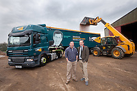 Farmer Julian Anyan and Will Wood, farm trader from Frontier Agriculture with the Frontier 'facetruck' being loaded with wheat at his Lincolnshire farm