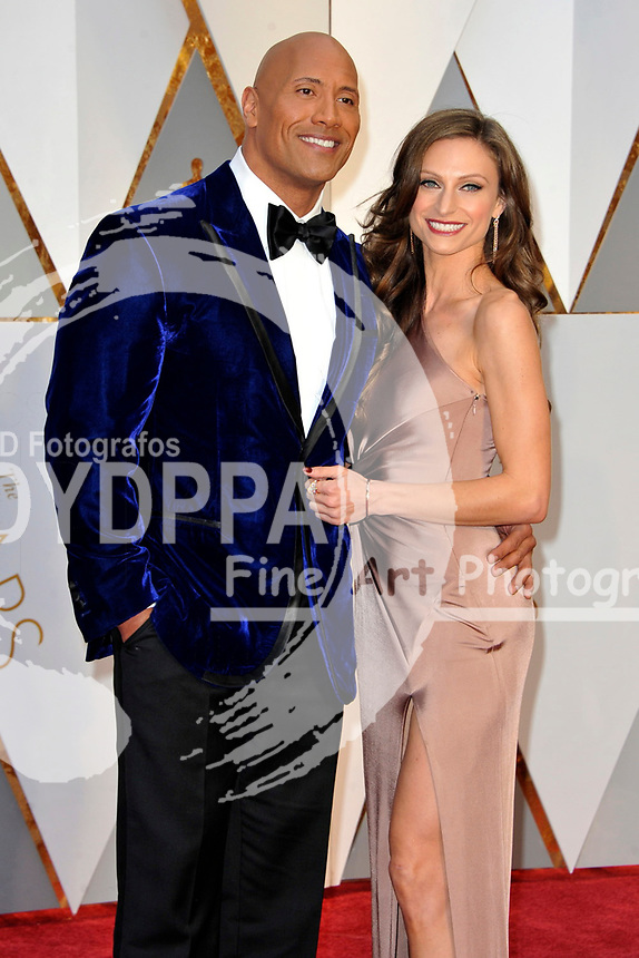Dwayne Johnson and his life partner Lauren Hashian attend the 89th Annual Academy Awards at Hollywood & Highland Center on February 26, 2017 in Hollywood, California.