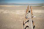 Fishing pier into the mud at the mouth of the Alamo River, Salton Sea, Calif.