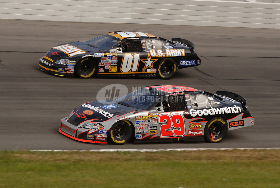 June 11, 2006; Long Pond, PA, USA; Nascar Nextel Cup driver Kevin Harvick (29) races Joe Nemechek (01) during the Pocono 500 at Pocono Raceway. Mandatory Credit: Mark J. Rebilas..