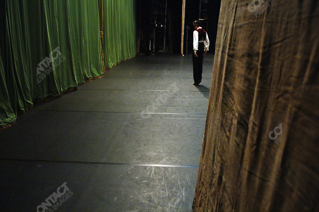Vitaly Biktimirov warmed up in the minutes before the curtain went up for Massine's Le Tricorne at the Bolshoi Theatre's New Stage in which he was dancing the lead male role. Moscow, Russia, January 25, 2007