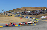 Jun. 21, 2009; Sonoma, CA, USA; NASCAR Sprint Cup Series driver Juan Pablo Montoya (42) leads Joey Logano (20) during the SaveMart 350 at Infineon Raceway. Mandatory Credit: Mark J. Rebilas-