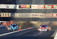 Nov 9, 2013; Pomona, CA, USA; NHRA funny car driver Bob Tasca III (right) races alongside Jeff Diehl during qualifying for the Auto Club Finals at Auto Club Raceway at Pomona. Mandatory Credit: Mark J. Rebilas-
