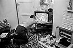 1970s apartment, interior, family at home watching TV, no zapper to tune in TV having to stretch across to change channels. They are watching tuning into The Regiment staring John Hallam  and Wendy Williams