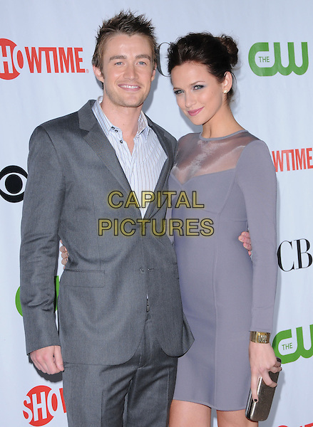 ROBERT BUCKLEY & SHANTEL VanSANTEN.The CBS, CW & Showtime TCA Party held at The Huntington Library in San Marino, California, USA. .August 3rd, 2009                                                                   half length grey gray suit blue purple sheer long sleeves dress silver clutch bag .CAP/RKE/DVS.©DVS/RockinExposures/Capital Pictures.
