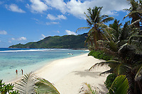Seychelles, Island Mahe, Anse Royale: two men at the beach