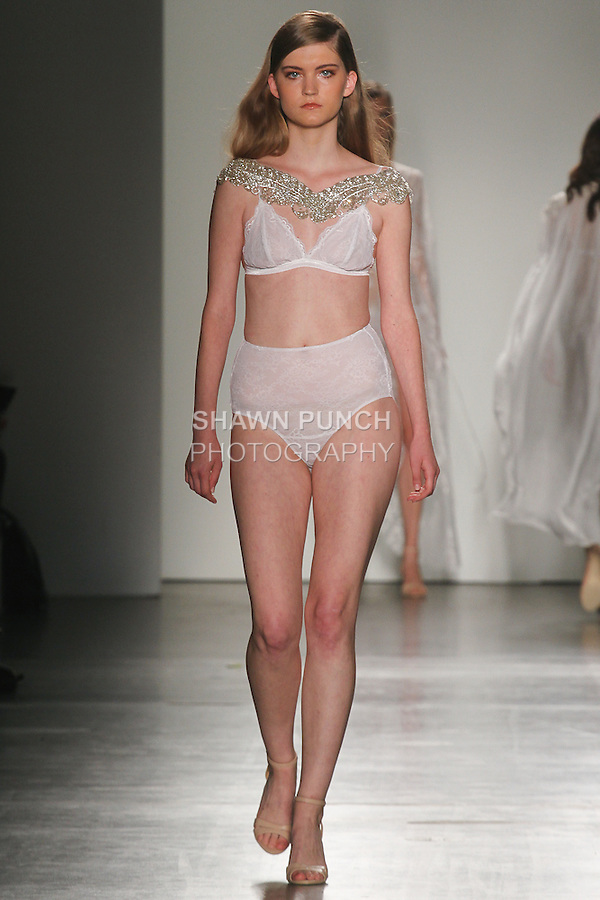 Model walks runway in an outfit from Mae's Sunday lingerie collection by Becca Collins and Kara Sandeman, for Fashion Palette Australian Evening & Bridal Show Spring Summer 2016, duing New York Fashion Week Spring 2016.