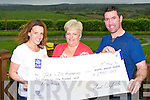Ted and Fiona Clifford presents a cheque of €2950 to Eileen Ní Mhurchú for the Jack and Jill foundation at the home on Monday evening
