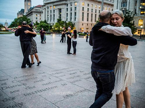 Couple dance the Tango on Freedom Plaza in Washington, DC